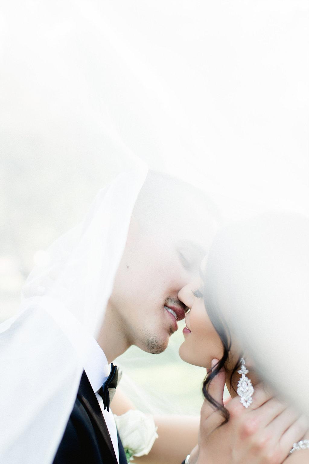 Creative Bride and Groom Wedding Portrait Under Veil   St. Petersburg Photographer Ailyn La Torre
