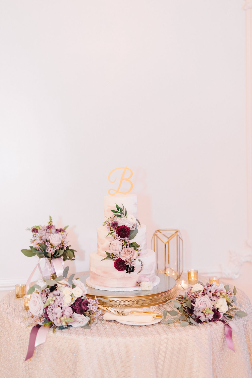 Three Tier Ivory White And Mauve Marble Wedding Cake With