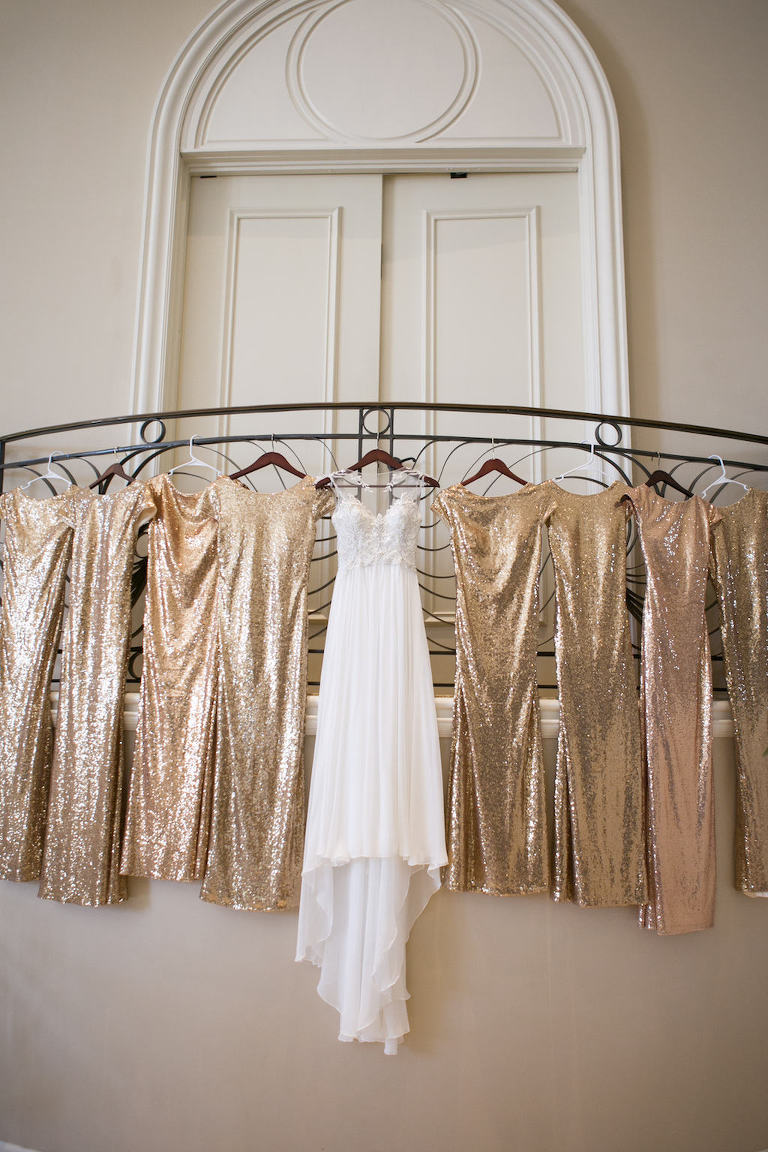 Maggie Sottero A-Line Illusion Wedding Dress with Lace Applique and Rhinestone Beaded Bodice, Gold Sequin Bridesmaid Dresses on Hangers | Sarasota Wedding Photographer Carrie Wildes Photography