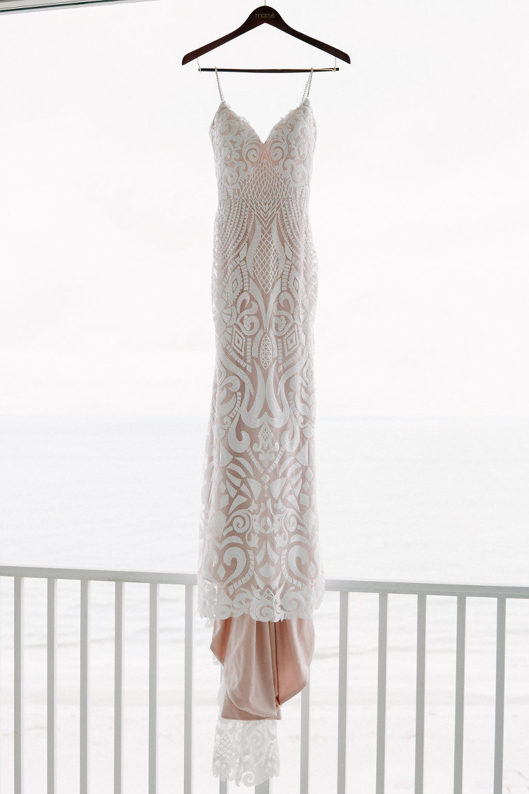 Plunging Neckline Ivory Sequin Lace and Nude Lining Spaghetti Strap Wedding Dress on Hanger | Tampa Bay Photographer Grind and Press Photography