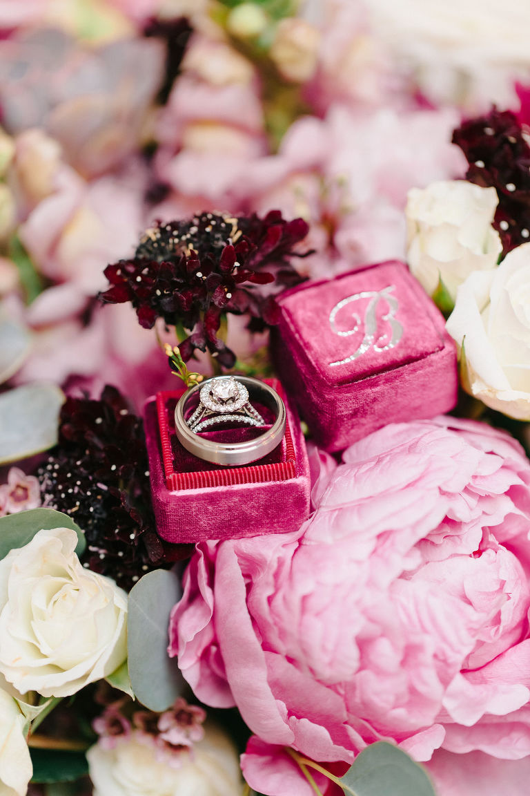 Velvet Dark Pink Ring Box with Wedding and Engagement Ring on Bed of Flowers, Pink Peony, White Roses, and Dark Purple Flowers | Tampa Bay Wedding Planner Burlap to Lace