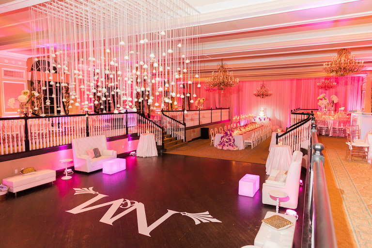 Elegant Hotel Ballroom Wedding Reception Decor with White Couch Lounge Area, Custom Projection Lighting, Pink Uplighting, Hanging White Roses | St Pete Beach Historic Hotel Wedding Venue The Don CeSar