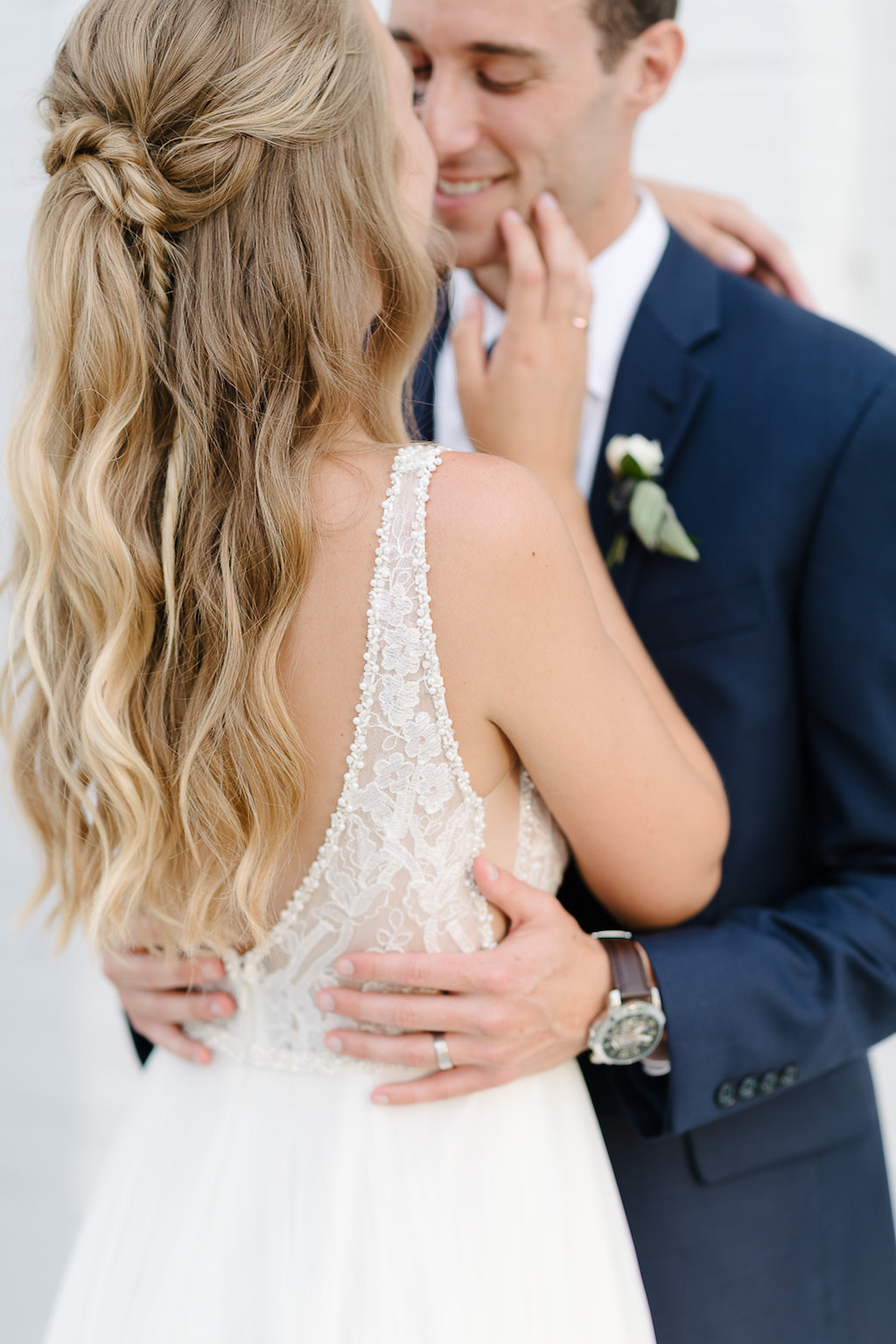 Bride and Groom Wedding Portrait, Groom in Navy Blue Suit and Watch, Bride in White A-Line Illusion Tank Top Strap Plunging V-Neckline Lace and Beaded Bodice Wedding Dress and Braided Half Up-Do