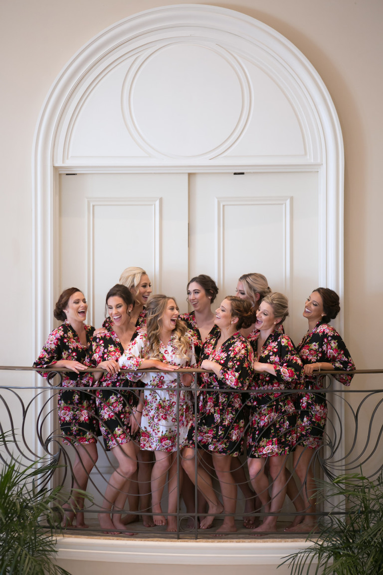 Balcony Bridal Party Getting Ready Portrait, Bridesmaids in Matching Black and Pink Floral Silk Robes, Bride in White Floral Silk Robe | Sarasota Wedding Photography Carrie Wildes Photography