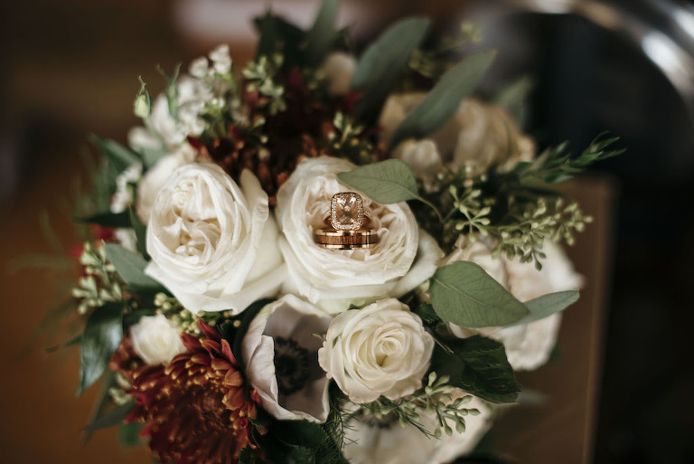 Vintage Inspired Wedding Bouquet with Ivory Roses, Burgundy Flowers and Greenery Bouquet with Rose Gold Engagement Ring and Wedding Ring | Tampa Bay Planner Kelly Kennedy Weddings and Events