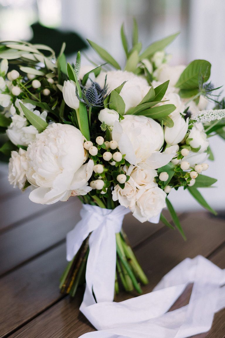 White Peonies and Roses and Greenery Wedding Bouquet Wrapped in Ribbon