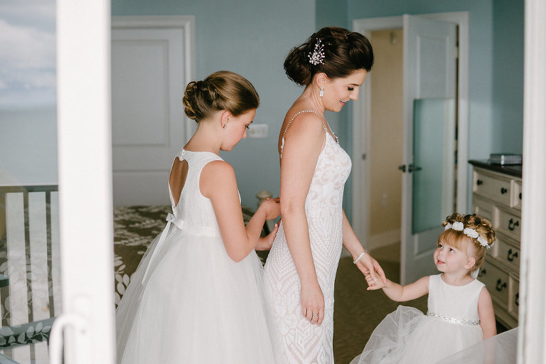 Bride Getting Ready Portrait with Flower Girls in White Tulle Skirt Dresses, Bride in Plunging Neckline Ivory Sequin Lace and Nude Lining Rhinestone Spaghetti Strap Wedding Dress | Tampa Bay Photographer Grind and Press | Hair and Makeup Michele Renee the Studio