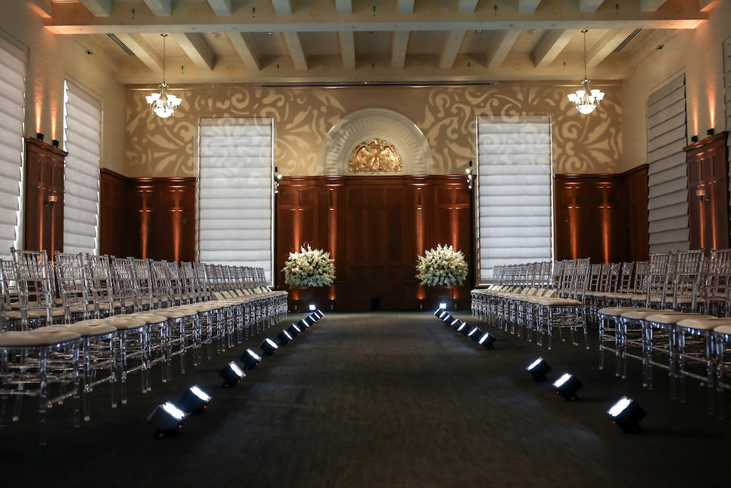 Clear Acrylic Chiavari Chairs from Kate Ryan Rentals   White Floral Bouquets on Clear Acrylic Stands   Historic Downtown Tampa Venue Le Meridien   Marry Me Tampa Bay and Isabel O'Neil Bridal Fashion Runway Show 2018   Tampa Wedding Photographer Lifelong Photography Studios