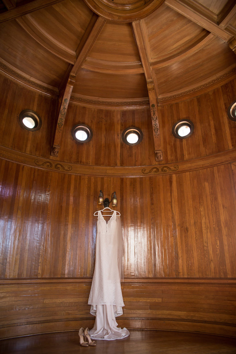 Lace Tank Top Strap Plunging Neckline Lace Wedding Dress Hanging in Wood Paneled Room | Tampa Bay Photographer Cat Pennenga Photography | Venue Powel Crosley Estate