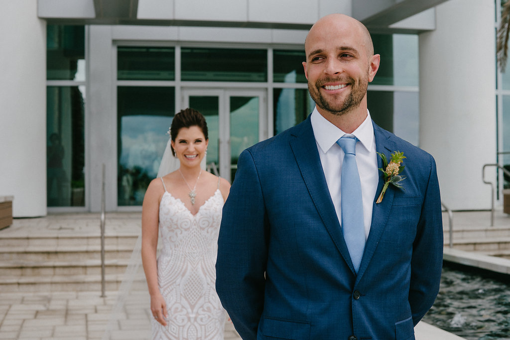 Outdoor Bride and Groom First Look Wedding Portrait, Groom in Navy Blue Suit, Pale Blue Tie and Pineapple Boutonniere | Tampa Bay Photographer Grind and Press | Hair and Makeup Michele Renee the Studio