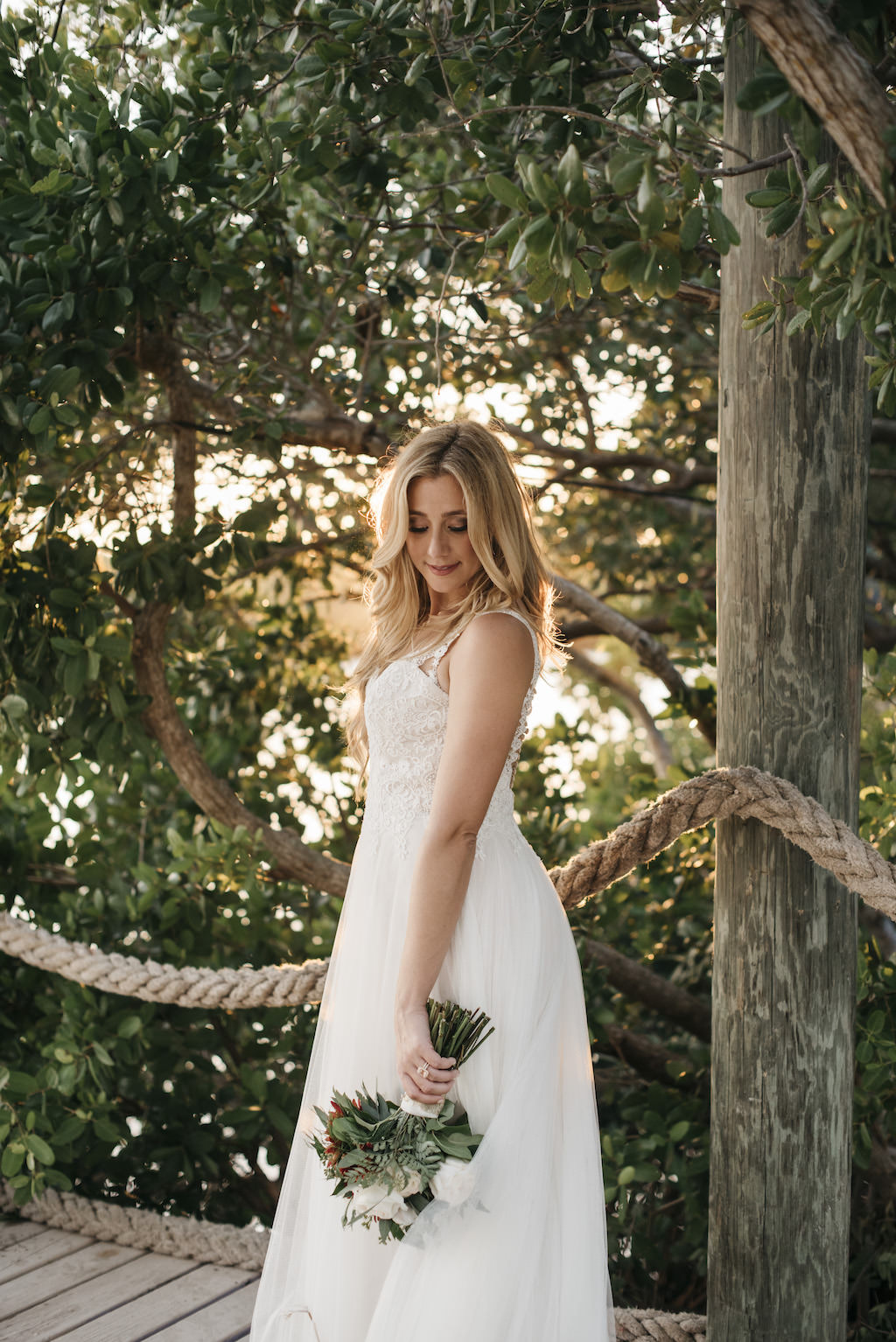 Outdoor Bride Wedding Portrait in A-Line Lace and Straps Wedding Dress with Greenery and Ivory Floral Bouquet | Tampa Bay Wedding Planner Kelly Kennedy Weddings and Events