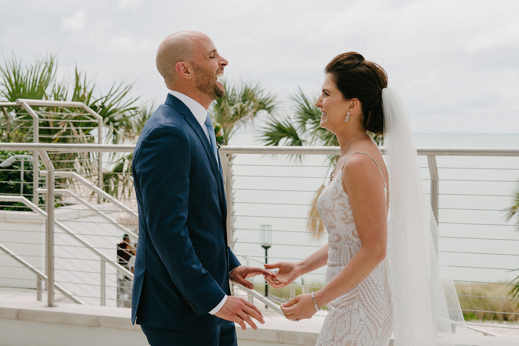 Outdoor Bride and Groom First Look Wedding Portrait, Groom in Navy Blue Suit, Bride in Plunging Neckline Sequin Lace, Nude Lining and Rhinestone Spaghetti Strap Wedding Dress and Veil | Tampa Bay Photographer Grind and Press | Hair and Makeup Michele Renee the Studio