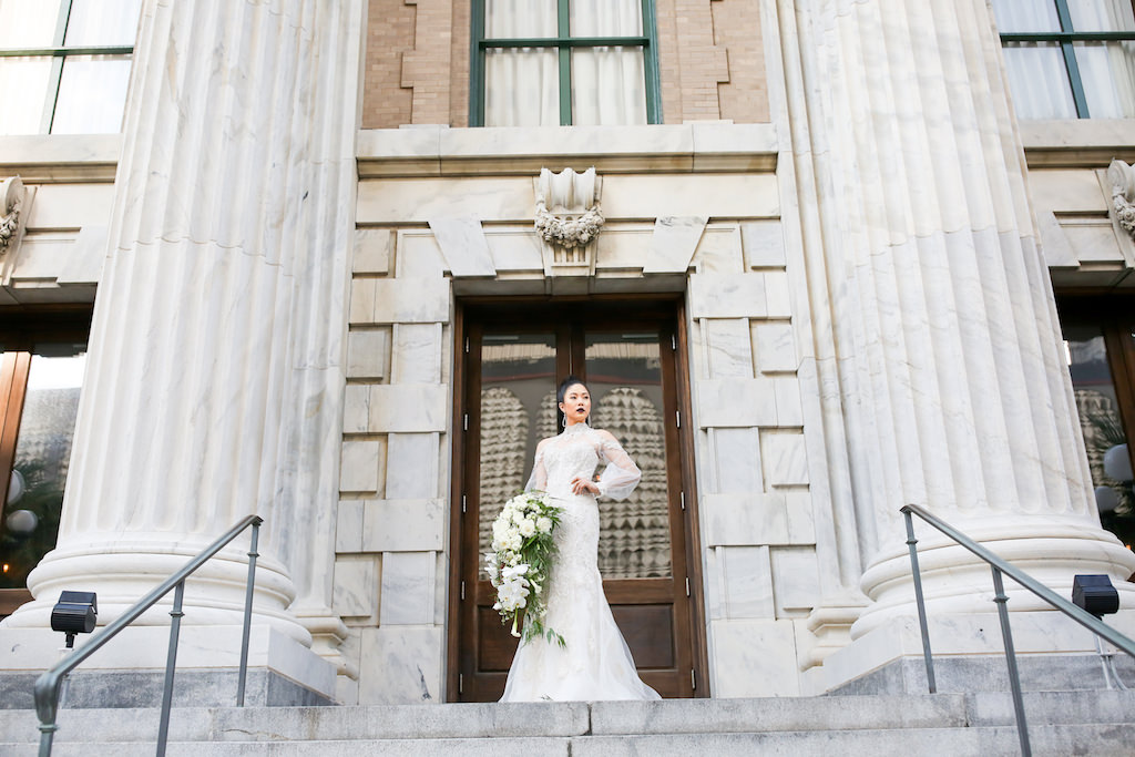 Illusion Long Sleeve Lace and Rhinestone High Neck Wedding Dress with White Orchid, Rose and Greenery Bouquet   Marry Me Tampa Bay and Isabel O'Neil Bridal Fashion Runway Show 2018   Tampa Wedding Photographer Lifelong Photography Studios   Historic Downtown Tampa Venue Le Meridien