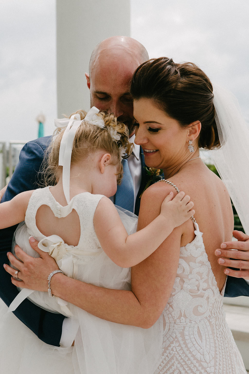 Outdoor Bride, Groom and Daughter/Flower Girl Wedding Portrait, Groom in Navy Blue Suit, Bride in Plunging Neckline Sequin Lace, Nude Lining and Rhinestone Spaghetti Strap Wedding Dress and Veil | Tampa Bay Photographer Grind and Press | Hair and Makeup Michele Renee the Studio