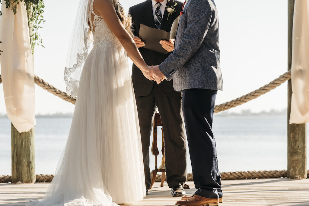 Outdoor Waterfront Bride and Groom Wedding Ceremony Portrait | Sarasota Wedding Planner Kelly Kennedy Weddings and Events