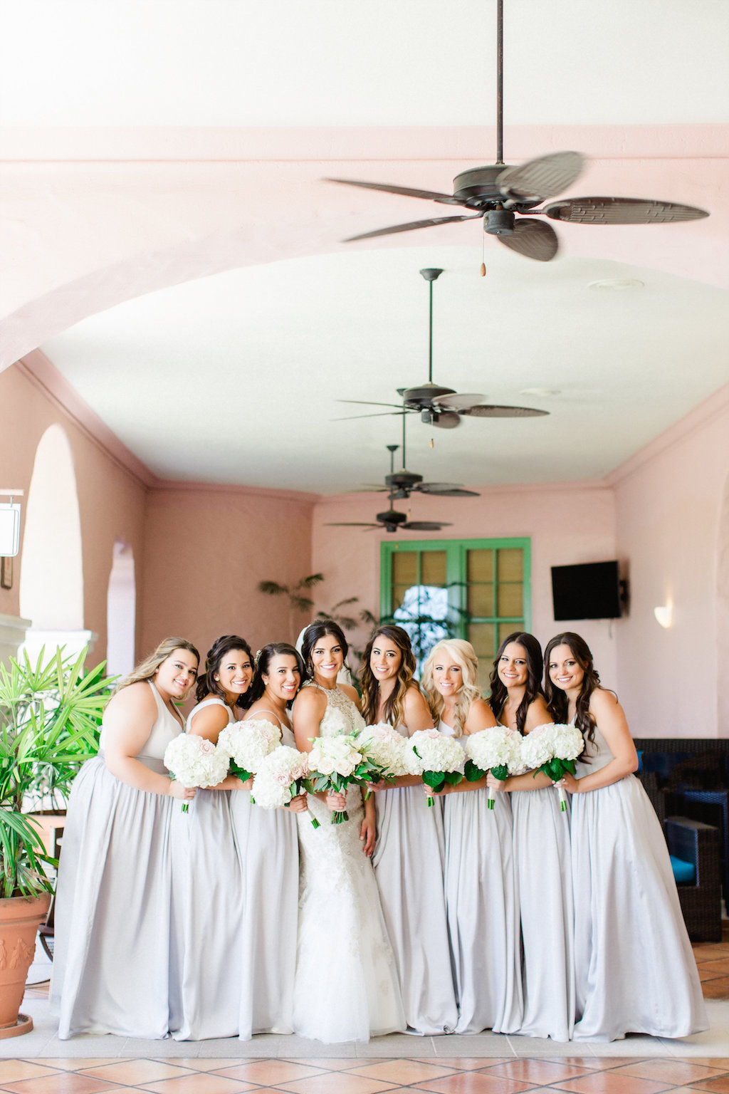 Bride and Bridesmaids Wedding Portrait in High Halter Lace and Rhinestone Bodice Wedding Dress, and Grey Bridesmaids Dresses with White Floral Bouquets   Tampa Hair and Makeup Artist Femme Akoi   St. Petersburg Photographer Ailyn La Torre Photography