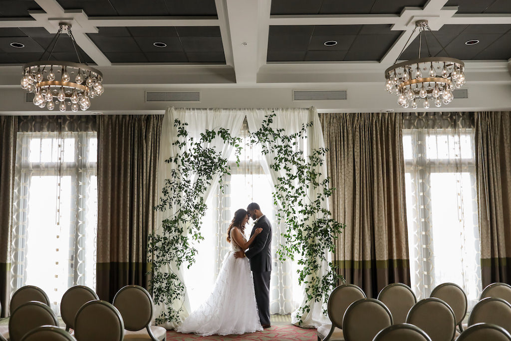 Elegant Boho Ballroom Wedding Ceremony Bride and Groom Portrait, White Draping Arch with Greenery | Tampa Bay Photographer Lifelong Photography Studios | Florist Cotton and Magnolia | Planner Parties A'La Carte | Downtown St.Pete Wedding Venue The Birchwood
