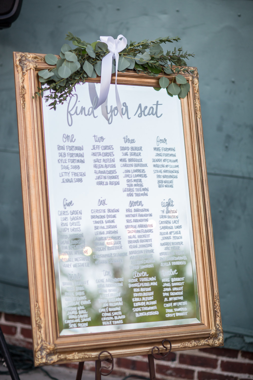 Wedding Reception Seating Chart On Mirror With Gold Frame And Greenery Decor Marry Me Tampa Bay Local Real Wedding Inspiration Vendor Recommendation Reviews