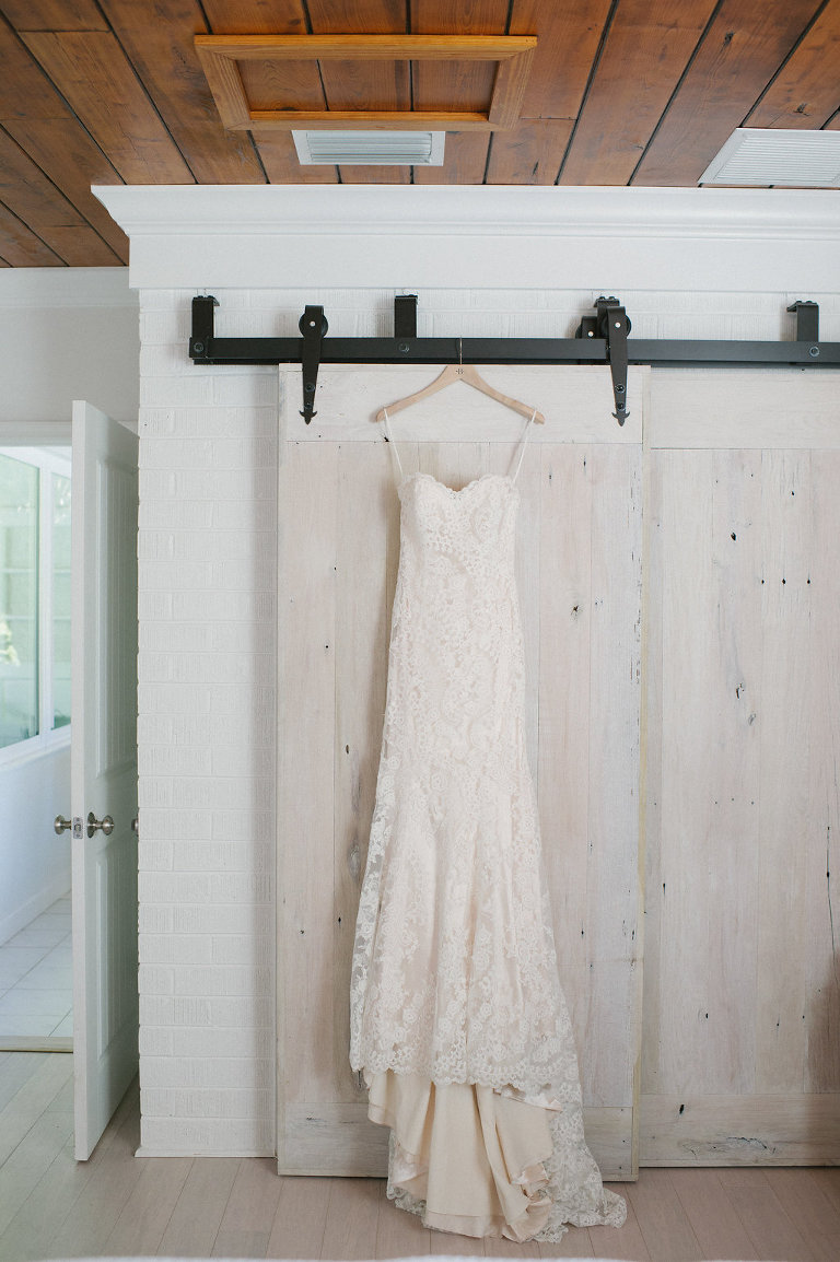 Sweetheart Strapless and Lace Wedding Dress Hanging from Door