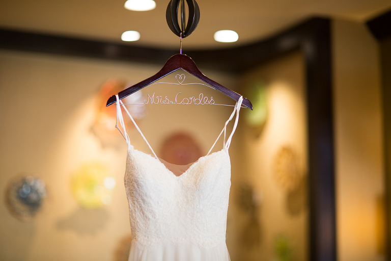 White Lace A-Line Spaghetti Strap Wedding Dress on Personalized Wooden and Wire Hanger