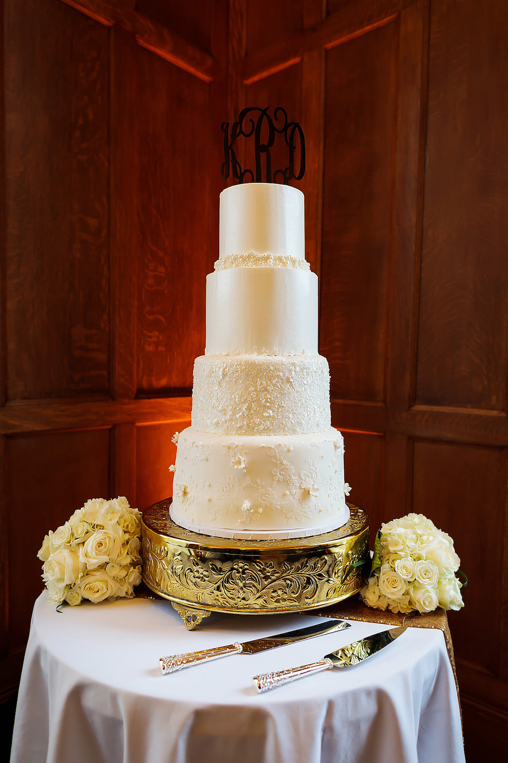 Four Tier Simple Elegant White Wedding Cake With Floral Accents On Vintage Gold Cake Stand And White Roses Bouquets Marry Me Tampa Bay Local Real Wedding Inspiration Vendor Recommendation