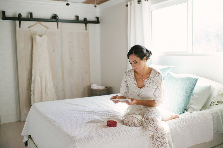 Bride Getting Ready Wedding Portrait in Lace Robe on Bed   Tampa Hair and Makeup Artist Femme Akoi