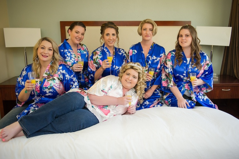 Bride and Bridesmaids Getting Ready Portrait, Bridesmaids in Royal Blue and Floral Silk Robes, Bride in White Floral Silk Robe | Tampa Bay Photographer Andi Diamond Photography