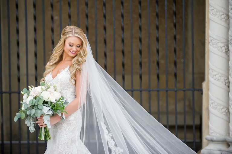 Outdoor Bride Wedding Portrait in Illusion Lace Tank Top Strap V Neckline Fit and Flare Wedding Dress with Cathedral Length Veil and White Rose and Greenery Bouquet | Tampa Bay Photographer Andi Diamond Photography | Hair and Makeup Michele Renee the Studio