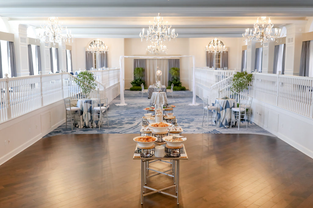 Renovated Ballroom at the Don Cesar Hotel Wedding Venue on St. Pete Beach, High Top Cocktail Tables with Blue and Silver Triangle Design Tablecloth, Tall Silver Chiavari Chairs with White Cushions | St. Petersburg Photographer Lifelong Photography Studios | Marry Me Tampa Bay Before 5 Networking Event | Designer UNIQUE Weddings and Events | Rentals Over the Top Linens and A Chair Affair