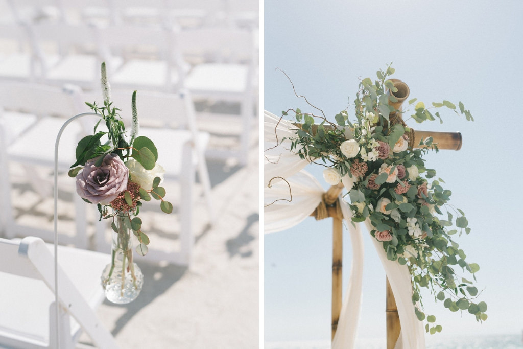 Outdoor Beach Wedding Ceremony Decor, Wooden Arch with White Linen Drapery, Greenery, White and Blush Pink Florals, White Wooden Folding Chairs, Floral Bouquets on Stands | Tampa Bay Photographer Kera Photography | St. Pete Beach Wedding Venue Tradewinds Island Resort | Rentals A Chair Affair