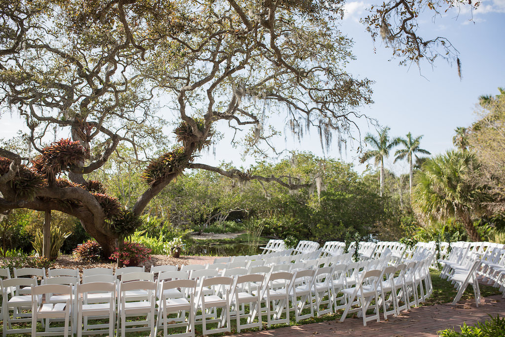 Outdoor Florida Garden Wedding Ceremony Decor, White Folding Chairs in Semi Circle Formation | Tampa Bay Photographer Cat Pennenga Photography| Sarasota Wedding Venue Marie Selby Botanical Gardens | Wedding Planner NK Productions