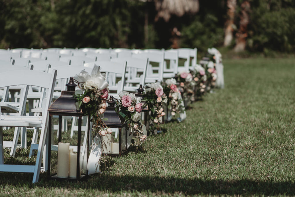 Garden Style Outdoor Sarasota Wedding Ceremony Decor White Wooden Folding Chairs Black Lanterns With Candles And Organic Blush Pink Dusty Pink Ivory And Greenery Florals Marry Me Tampa Bay Local