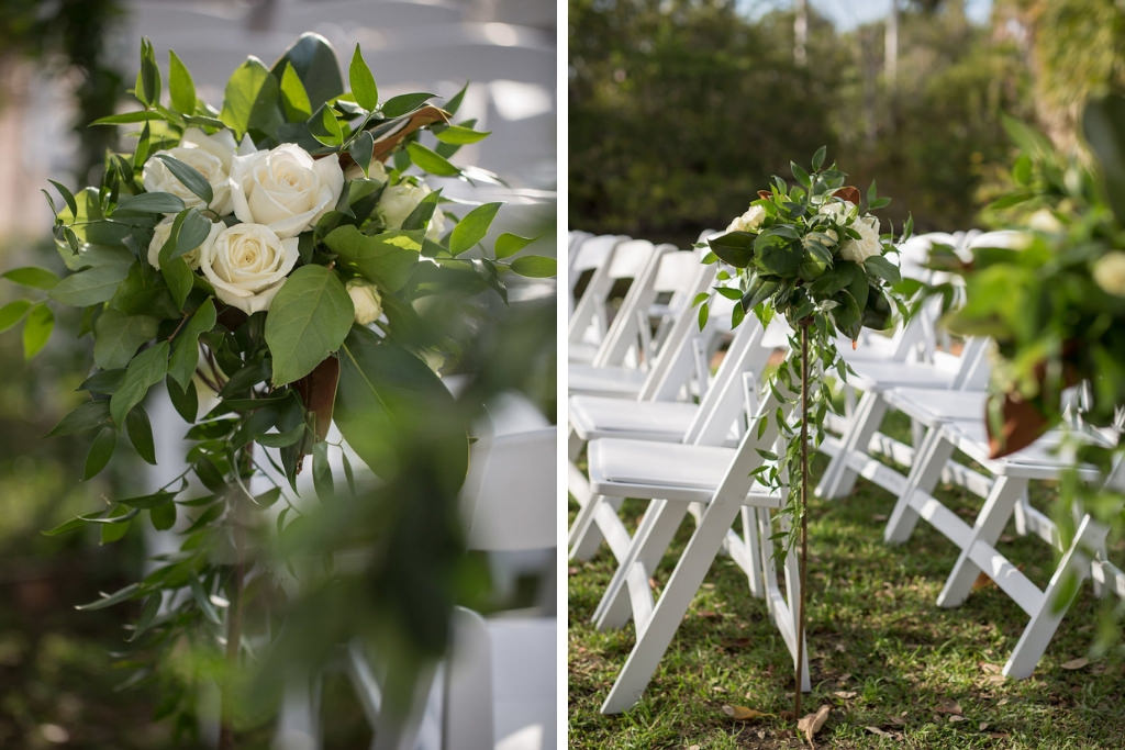 Outdoor Florida Garden Wedding Ceremony Decor, White Folding Chairs in Semi Circle Formation with Organic Greenery and White Rose Floral Bouquets on Tall Stands | Tampa Bay Photographer Cat Pennenga Photography| Sarasota Wedding Venue Marie Selby Botanical Gardens | Wedding Planner NK Productions