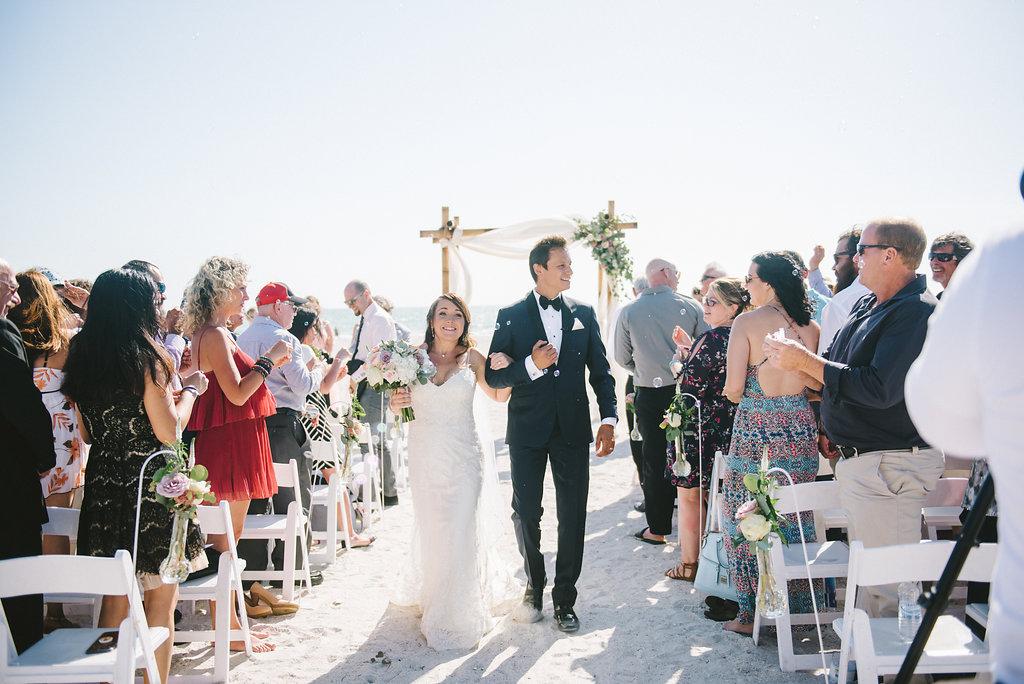 St. Pete Beach Outdoor Bride and Groom Ceremony Exit Wedding Portrait | Tampa Bay Photographer Kera Photography | St. Pete Beach Wedding Venue Tradewinds Island Resort