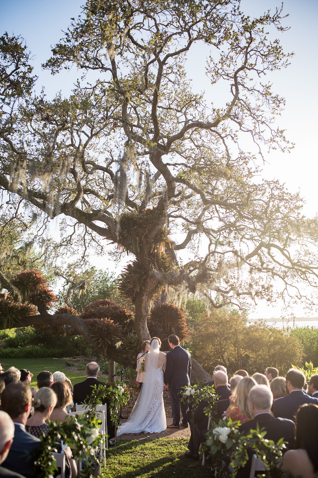 Sunset Florida Garden Bride and Groom Wedding Ceremony Portrait | Tampa Bay Photographer Cat Pennenga Photography| Sarasota Wedding Venue Marie Selby Botanical Gardens | Wedding Planner NK Productions