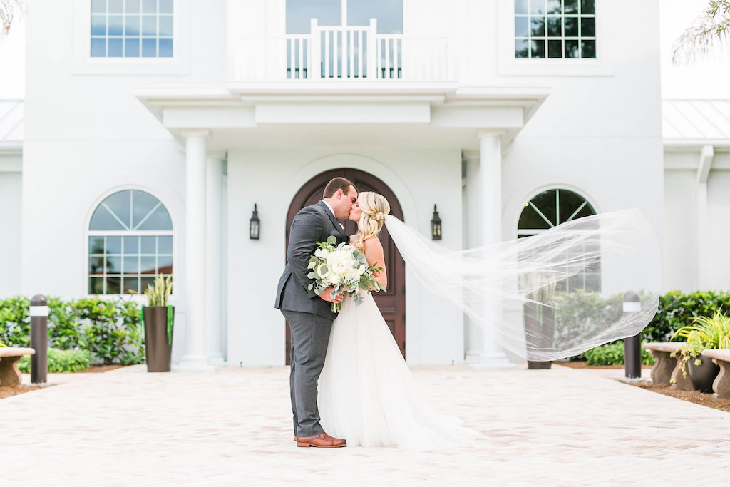 Florida Outdoor Bride and Groom Wedding Portrait with Veil Blowing in Wind | Clearwater Wedding Ceremony Venue Harborside Chapel