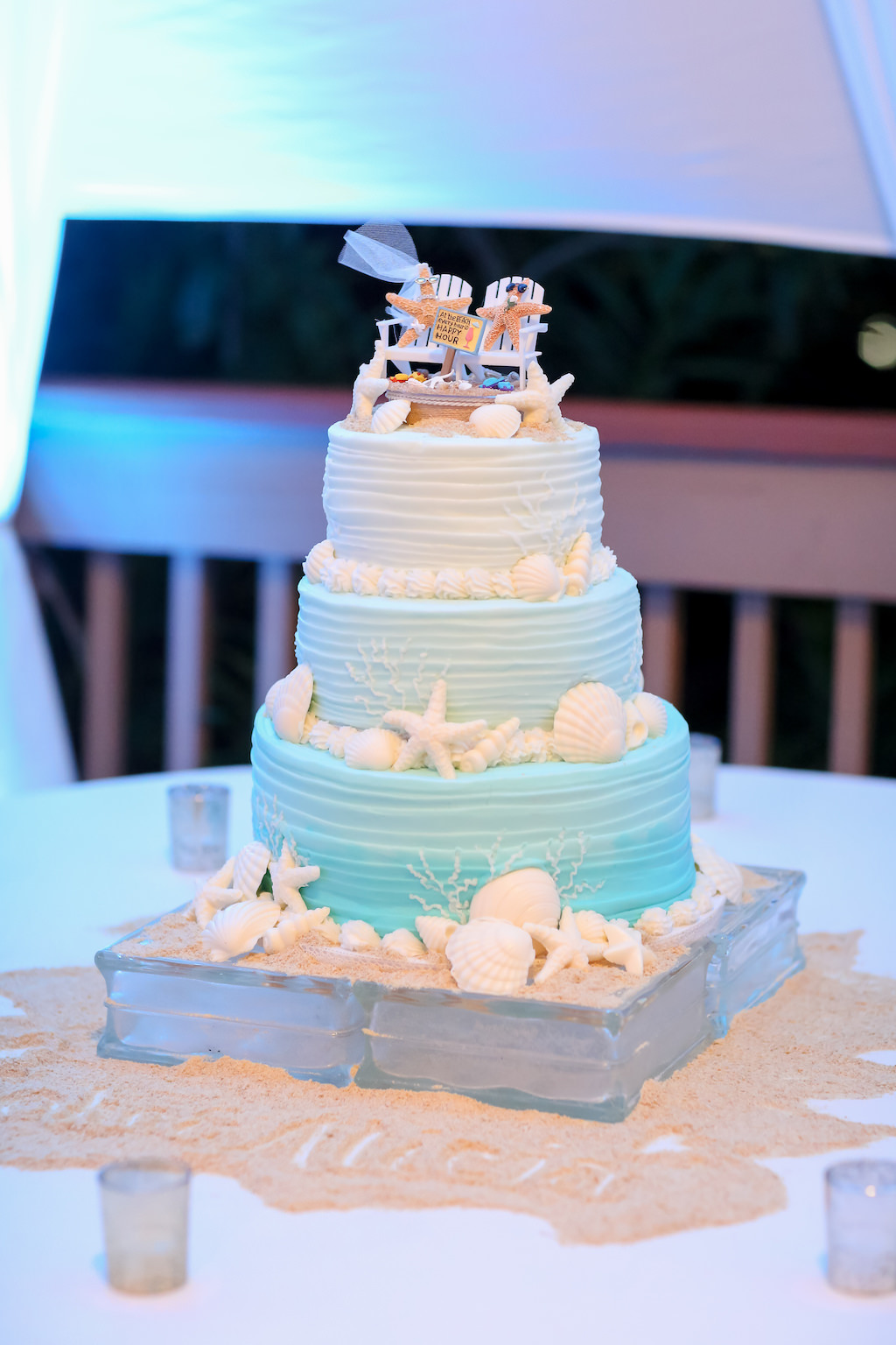 Beach Inspired Three Tier White And Blue Ombre Wedding Cake
