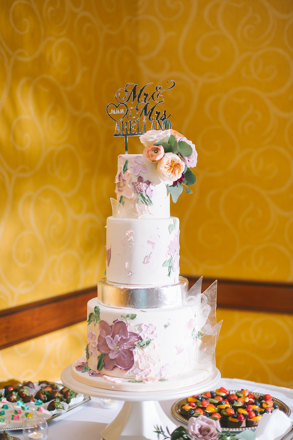 Elegant Four Tier Wedding Cake with Frosted Lilac Floral Decor and Silver Tier with Real Coral and Greenery Florals and Silver Lasercut Cake Topper | Tampa Bay Photographer Kera Photography | Wedding Cake Shop The Artistic Whisk