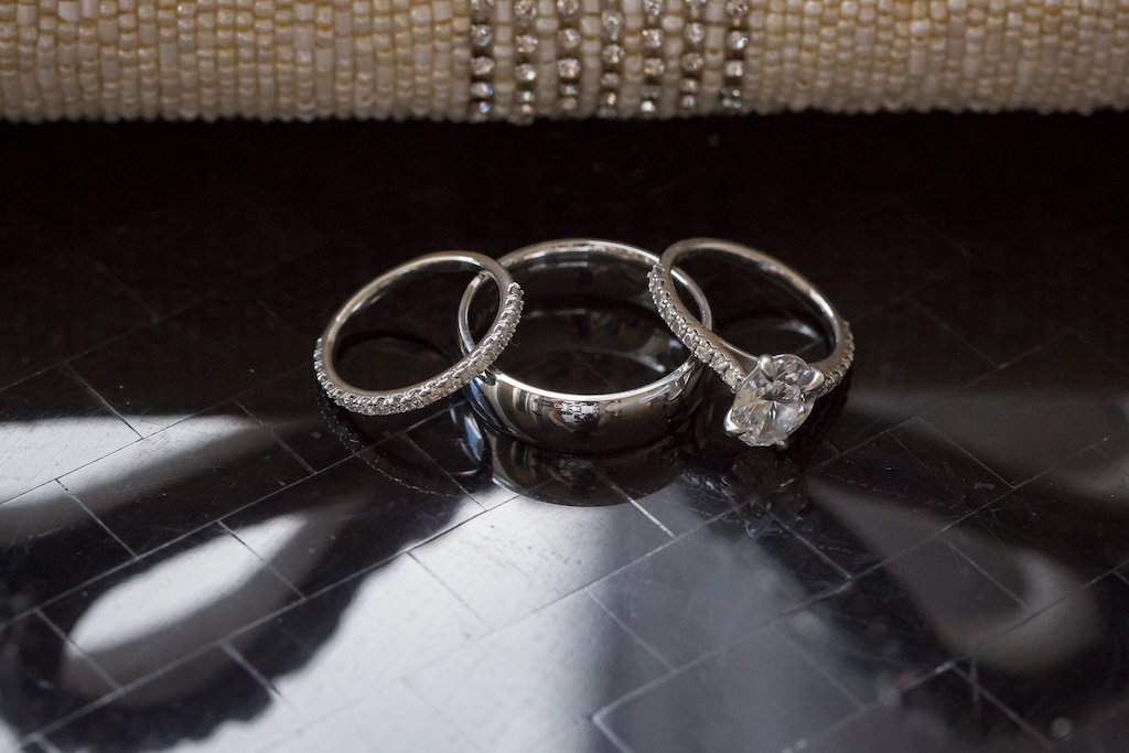 Oval Diamond Engagement Ring With Diamond Band And Bride And Groom