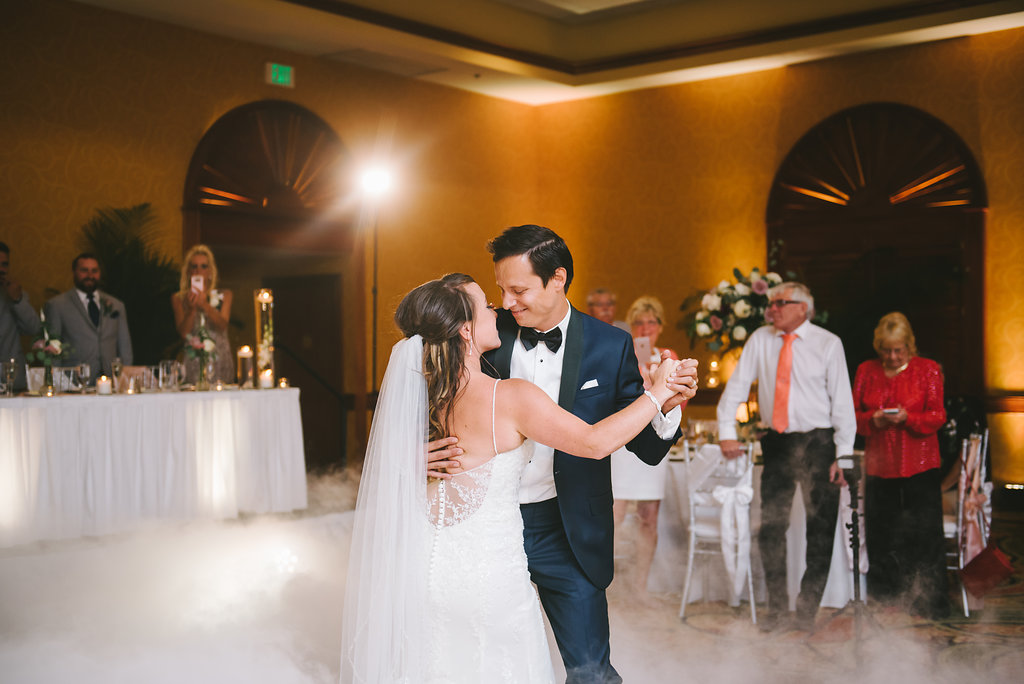 Ballroom Bride and Groom First Dance Reception with Smoke/Fog Dancing on a Cloud Wedding Portrait | Tampa Bay Photographer Kera Photography | St. Pete Beach Wedding Venue Tradewinds Island Resort