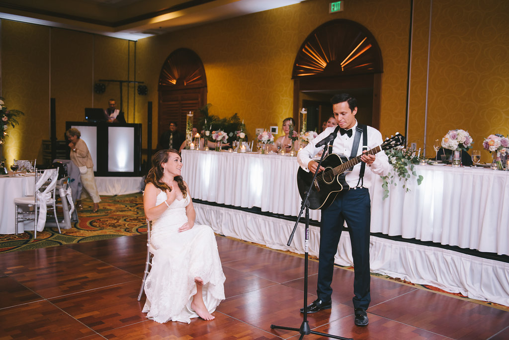 Groom Playing Guitar to Bride Wedding Ballroom Portrait | Tampa Bay Photographer Kera Photography | St. Pete Wedding Venue Tradewinds Island Resort