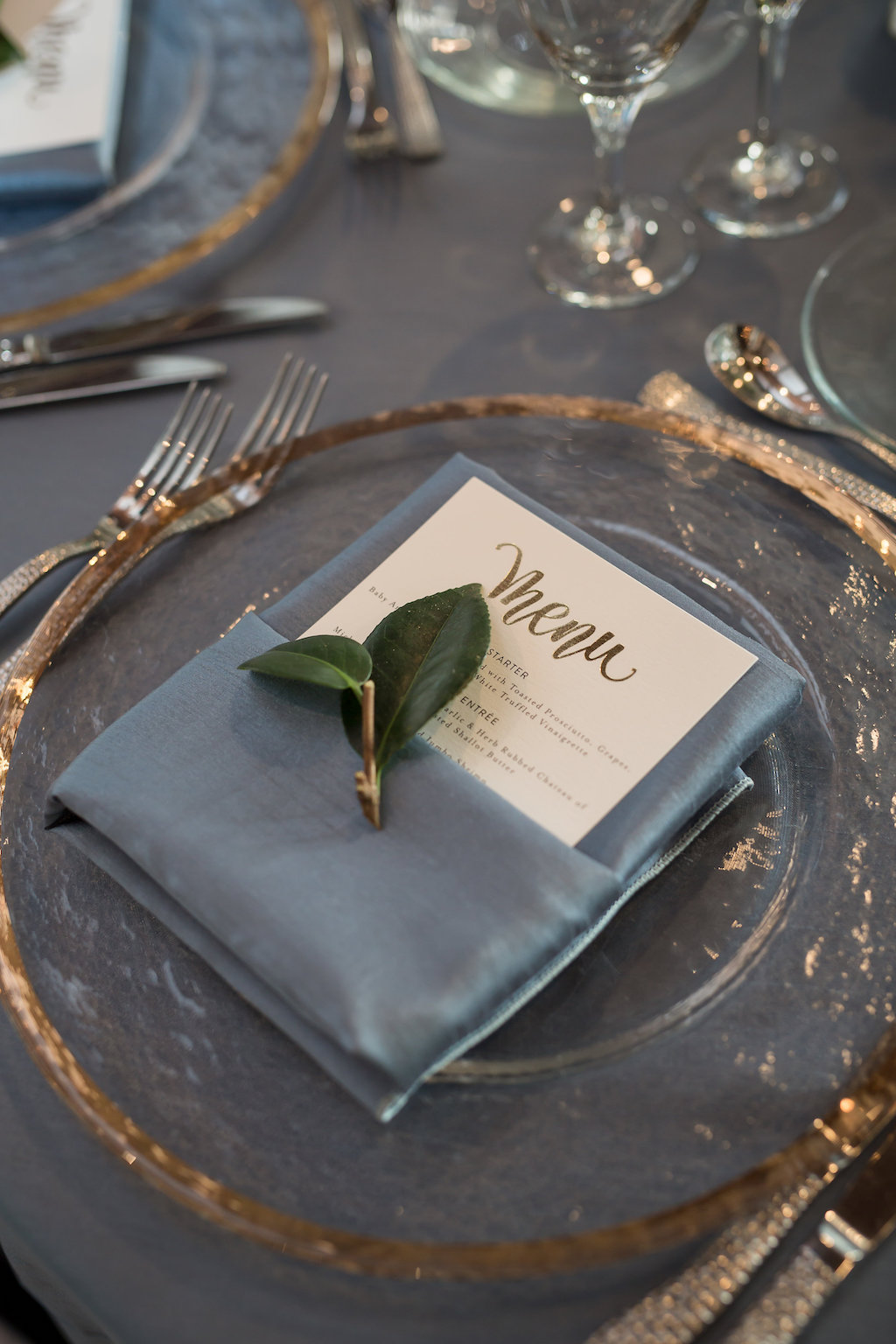 Elegant, Modern Wedding Reception Decor, Clear and Gold Rimmed Charger, Dusty Blue Linen, Gold Foil Menu and Green Leaf | Tampa Bay Photographer Cat Pennenga Photography| Sarasota Wedding Planner NK Productions