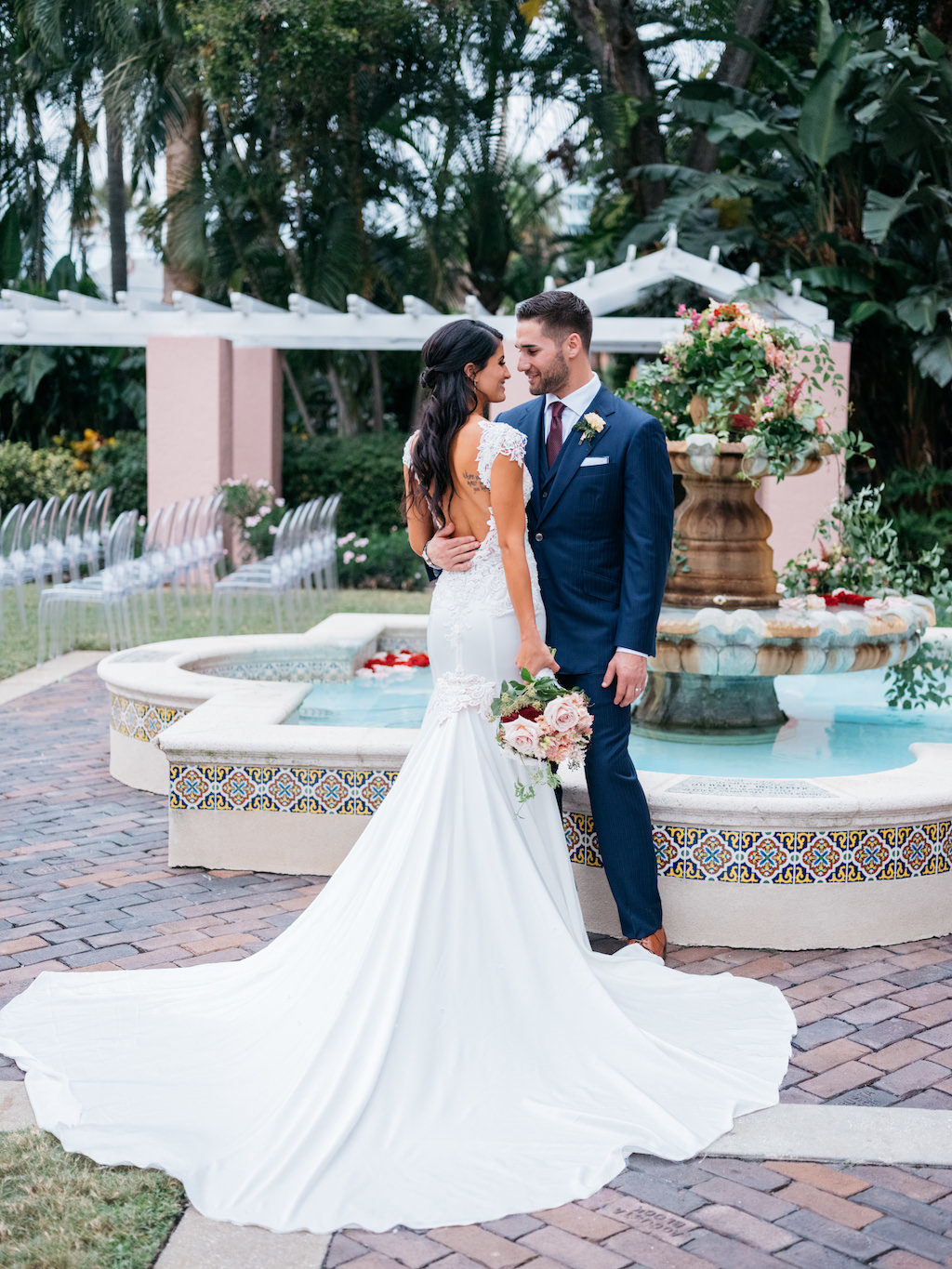 Romantic Bride and Groom, Professional Tampa Bay Rays Baseball Player Kevin Keirmaier, Hotel Courtyard Wedding Portrait, Bride in Low Back Fitted Lace and Illusion Cap Sleeve Pnina Tornai Wedding Dress | Tampa Bay Wedding Planner Parties A'la Carte | St. Petersburg Hotel Wedding Venue The Vinoy Renaissance