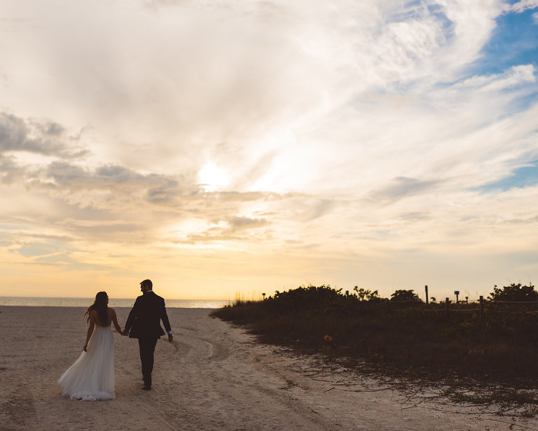 Sunset Waterfront Beach Bride and Groom Wedding Portrait | St. Petersburg Wedding Venue Postcard Inn on the Beach