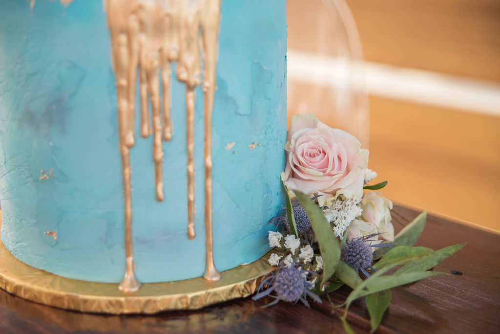 Two Tier Dusty Blue Cake With Gold Drip Detailing And Real Floral