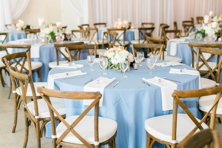 Wedding Reception Decor, Round Tables with Blue Tablecloths, Wooden Chiavari Chairs and White Linen Cushions, White, Blush Pink and Greenery Low Floral Centerpiece | Tampa Bay Wedding Rentals A Chair Affair