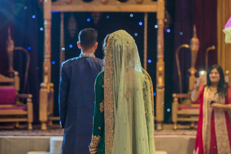 Glamorous Tampa Bay Indian Wedding Bride and Groom First Look Portrait, Bride in Traditional Green and Gold Saree
