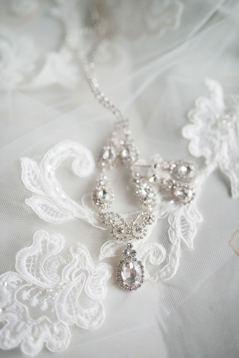 Diamond Drop Necklace and Earrings on Lace and Tulle Veil | Tampa Bay Wedding Photographer Kristen Marie Photography