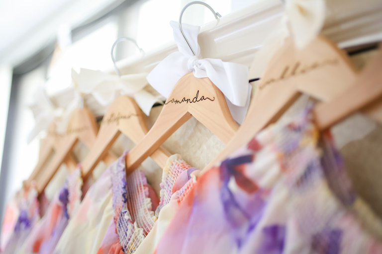 Colorful Floral Bridesmaids Dresses on Personalized Wooden Hangers | Tampa Bay Wedding Photographer Lifelong Photography Studios