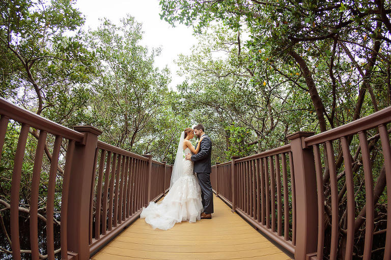 Outdoor Creative Bride and Groom Wedding Portrait on Walkway Under Trees